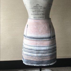 Pink, cream, blue tweed skirt with side zips.
